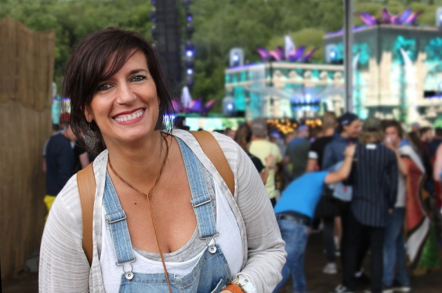 woman at festival with crowd behind her