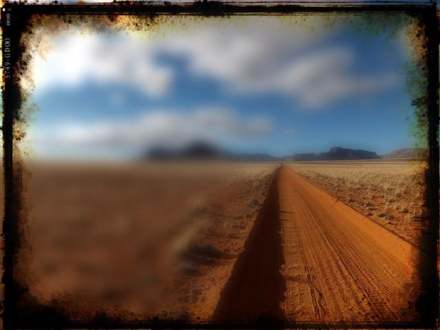 namibia dirt road leading to desert