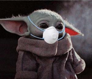Baby Yoda wearing a mask